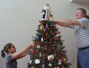 My daughter & husband decorating the tree.