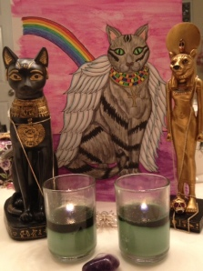 "Candles to Bastet for a new cat with ""The Cat"" card from my ""Egyptian Lenormand"" in the background."