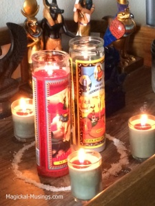 "3 of my votives with 10"" high saints candles."