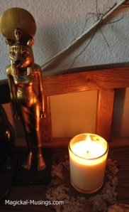 A Metatron candle burning in front of my statue of Sekhmet.