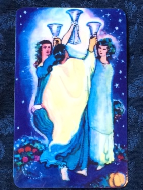 "The 3 of Cups from ""The Illuminated Starlight Tarot,"" by Carol Herzer."