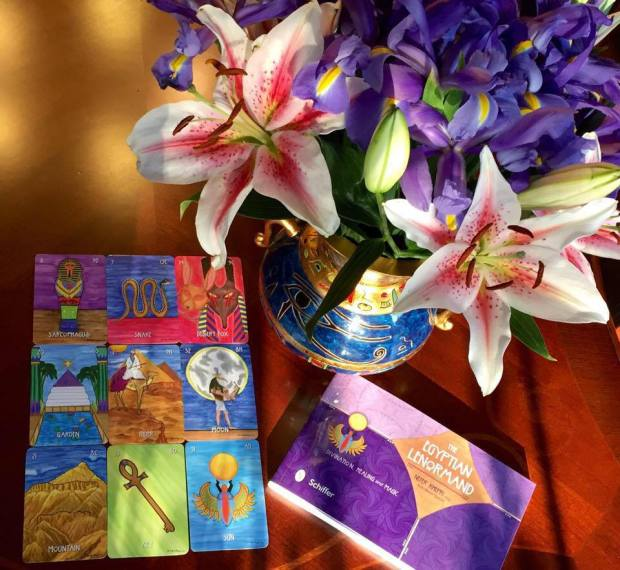 A photo of a Square of 9 reading with my Egyptian Lenormand deck (Schiffer, 2015), the guidebook & a lovely bouquet of flowers from my husband.