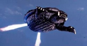 Gamera using his jet rockets to fly through the air.