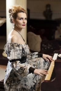 Victorian woman playing the piano. Image by Patrisyu. Image # 100265938 at freedigitalphotos.net