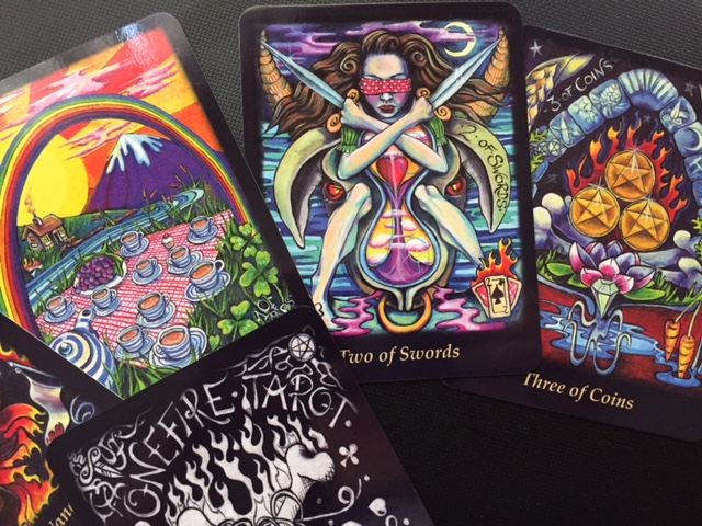 The 10 of cups, 2 of Swords & 3 of Coins from The Bonefire Tarot by Gabi Angus-West. For readings visit http://magickal-musings.com. If you are a publisher seeking a reviewer feel free to email me at: IsisRaAnpu@gmail.com.